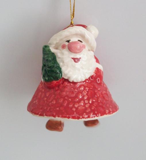 Christmas souvenir Santa with a Christmas tree
