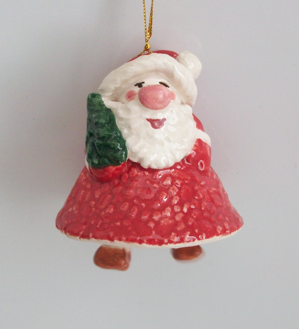 Christmas souvenir Santa with a Christmas tree